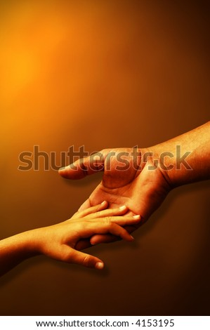 detail of a father hand holding his child hand over a warm background