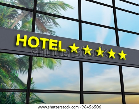 Detail of a five stars hotel with reflecting sky and palm trees