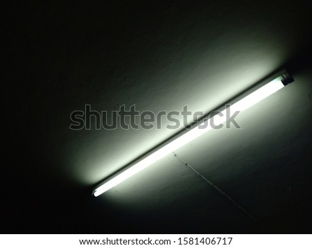 Detail of a fluorescent light tube on a wall. fluorescent light tube  space for any design