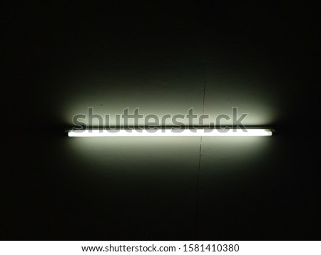 Detail of a fluorescent light tube on a wall. fluorescent light tube  space for any design.