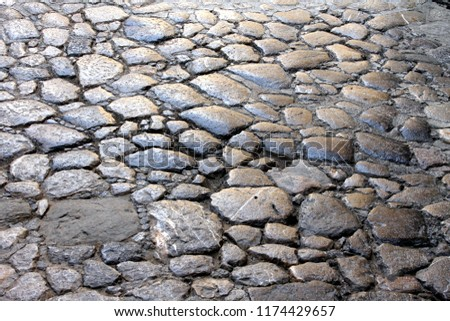 detail of a fragment of a stone paved floor of a street #1174429657