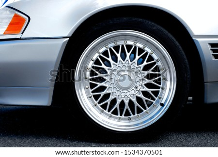 Detail of a front fender and wheel of a perfect silver luxury sports car. #1534370501