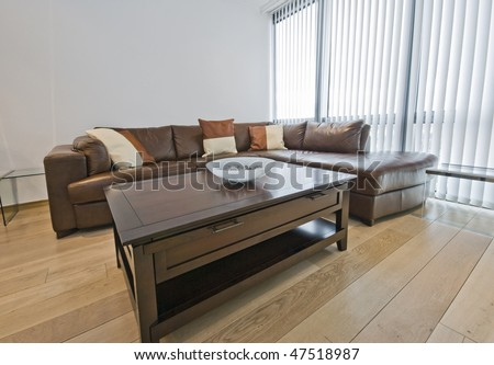 detail of a furnished living room with floor to ceiling windows