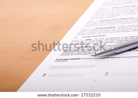detail of a generic contract with a pen to sign (selective focus) Note: fictitious contract