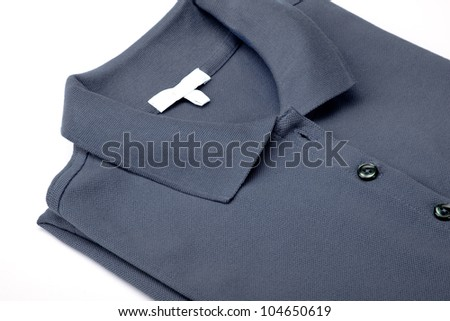 Detail of a gray polo shirt.