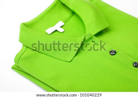 Detail of a green polo shirt on white