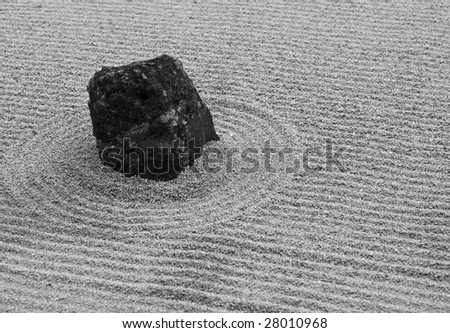 Detail of a japanese zen-stone garden. Black and white.
