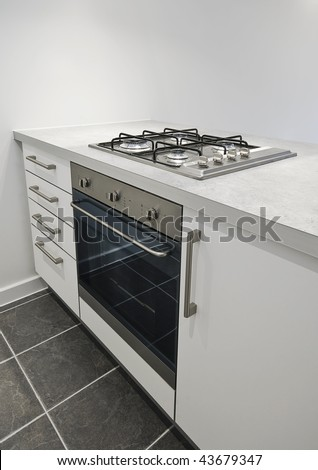 detail of a kitchen counter with oven and gas hob