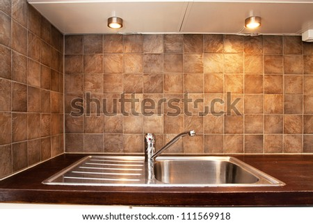 detail of a kitchen sink with tile