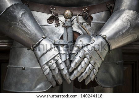 Detail of a knight armor with sword