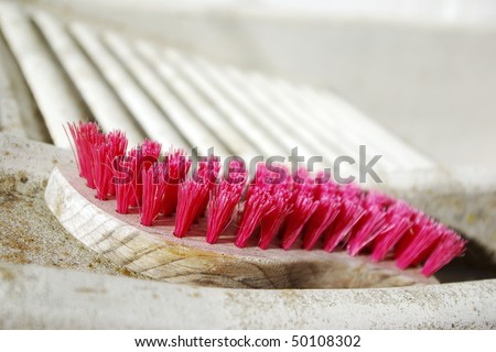 detail of a laundry hand-washing tub with an old pink brush