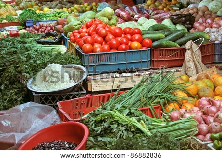 detail of a market stall with lots of various colorful fruits and vegetables