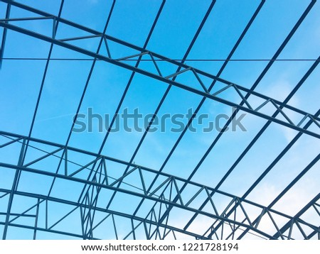 Detail of a metal structure construction with blue sky. #1221728194