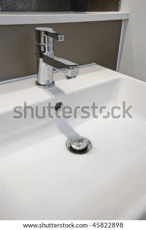 detail of a modern designer hand wash basin