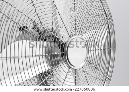 Detail of a modern metal electric fan with shiny blades. #227860036