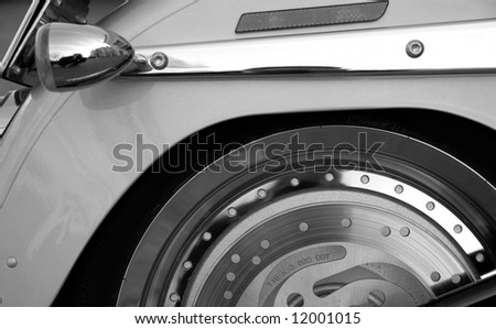 Detail of a motorbike tail and disk brake.