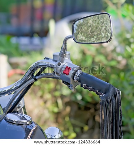 detail of a motorcycle rear view mirror