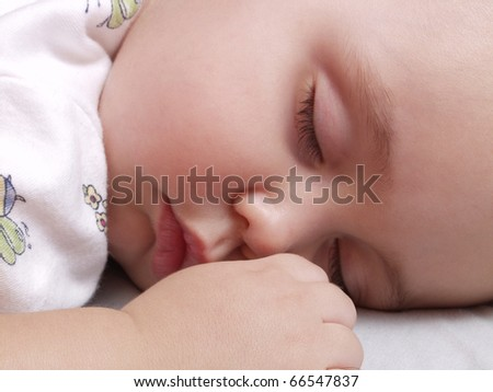 Detail of a newborn baby sleeping.