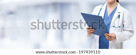 Detail of a nurse holding a clipboard