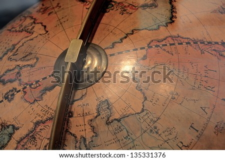Detail of a old map on a globe from the 18th century - stock photo