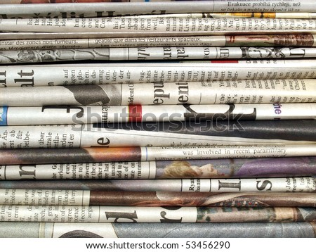 Detail of a pile of international newspapers