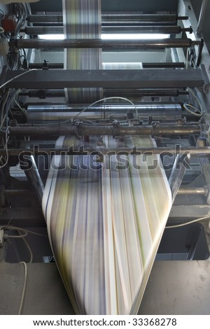 detail of a printing machine in production - stock photo