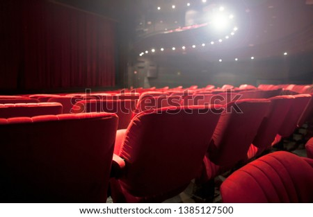 detail of a red seats at the theater #1385127500