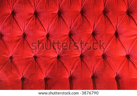 detail of a red velvet couch ideal as background
