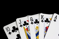 detail of a royal flush on black background