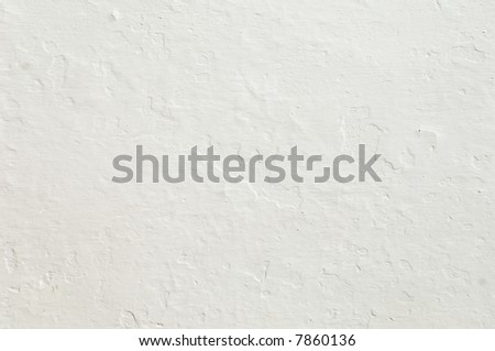 Detail of a rugged white wall suitable as background