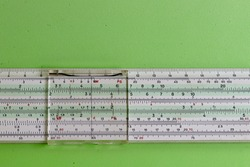 Detail of a section of a logarithmic slide rule, widely used until the early 1970s.