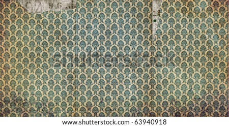 Detail of a section of old, worn and stained wallpaper