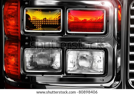 Detail of a shiny new headlamps on firetruck
