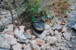detail of a shoe abandoned and worn by time. post earthquake