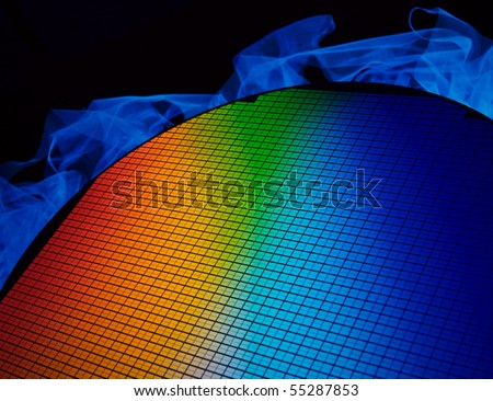 detail of a silicon chip wafer reflecting different colors