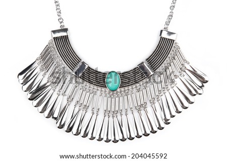 Detail of a silver statement necklace isolated on white