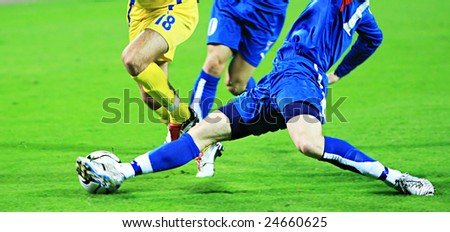 Detail of a soccer game with many players in action