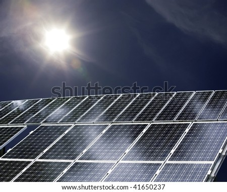detail of a solar power plant with sun shining on it