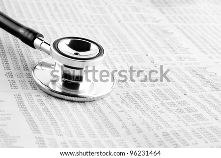 detail of a stethoscope on financial newspaper