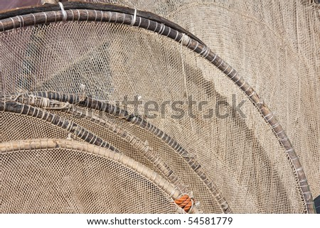 Detail of a tiny fishnet drying in the sun