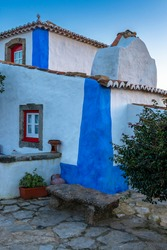 Detail of a traditional house painted in white and blue, near Mafra, Portugal.