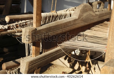 Detail of a traditional wooden hand weaving loom.
