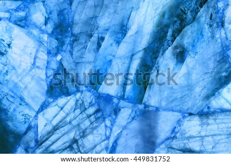 detail of a translucent slice of natural quartz agate marble stone. natural patterns and textures of minerals for background. backgrounds and wallpapers. abstract background