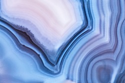 Detail of a translucent slice of natural stone agate. Natural concentric patterns and textures of minerals for background. Natural stone agate surfaces, backgrounds and wallpapers.