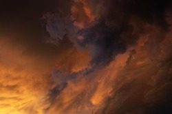 Detail of a very dark thundercloud in the evening in the light of the sunset