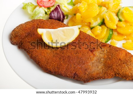detail of a viennese schnitzel on a plate