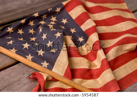 detail of a vintage American flag on a wood table