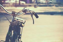 Detail of a Vintage Bicycle Handlebar Resting in the city Street (film look instagram effect)