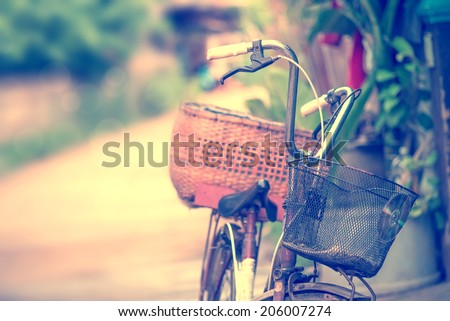 Detail of a Vintage Bicycle Resting in the countryside Street (vintage color toned image)