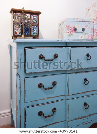 detail of a vintage chest of drawers with jewelery box